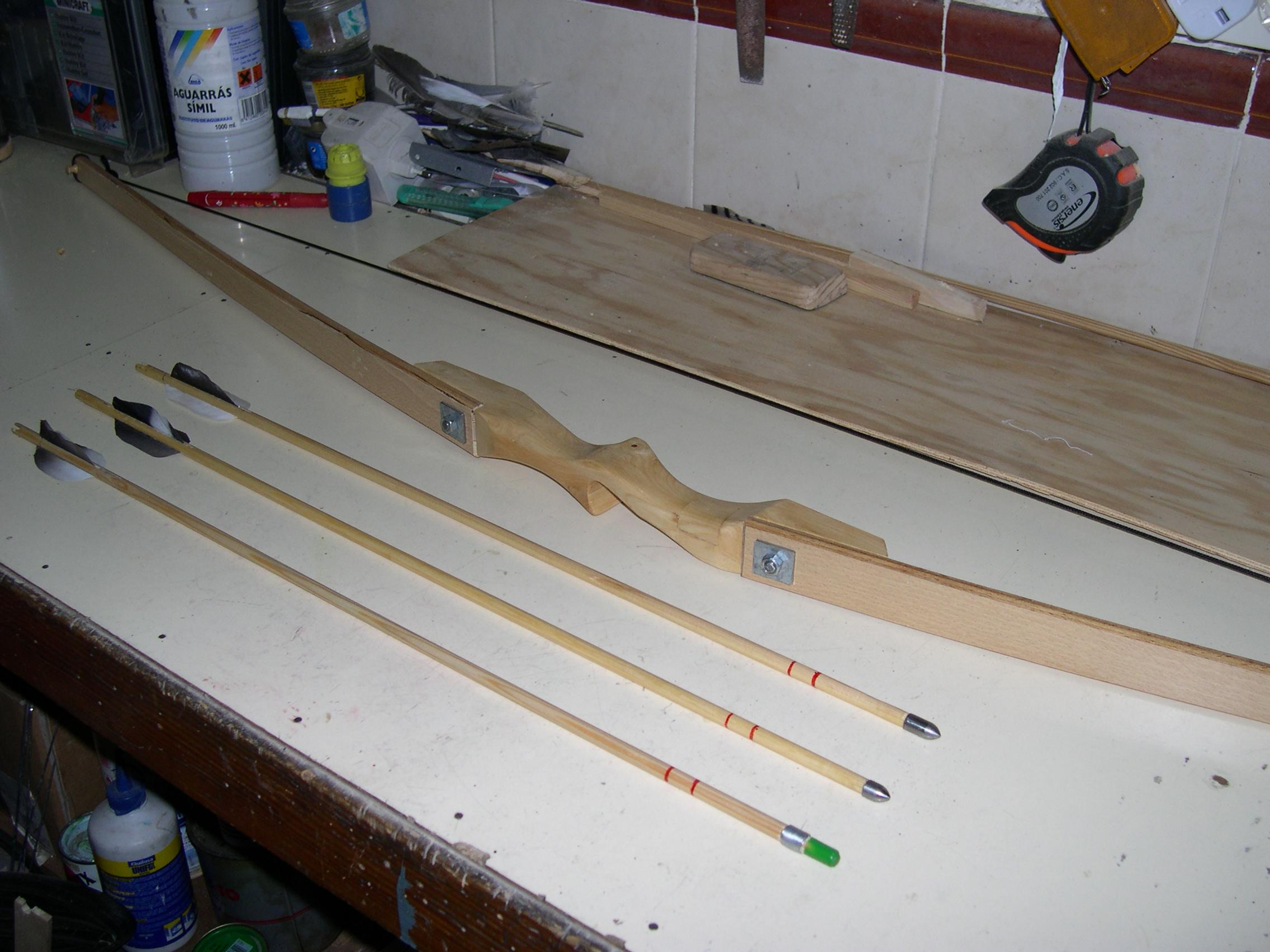 Arco casero con palas de somier for Bar casero de madera